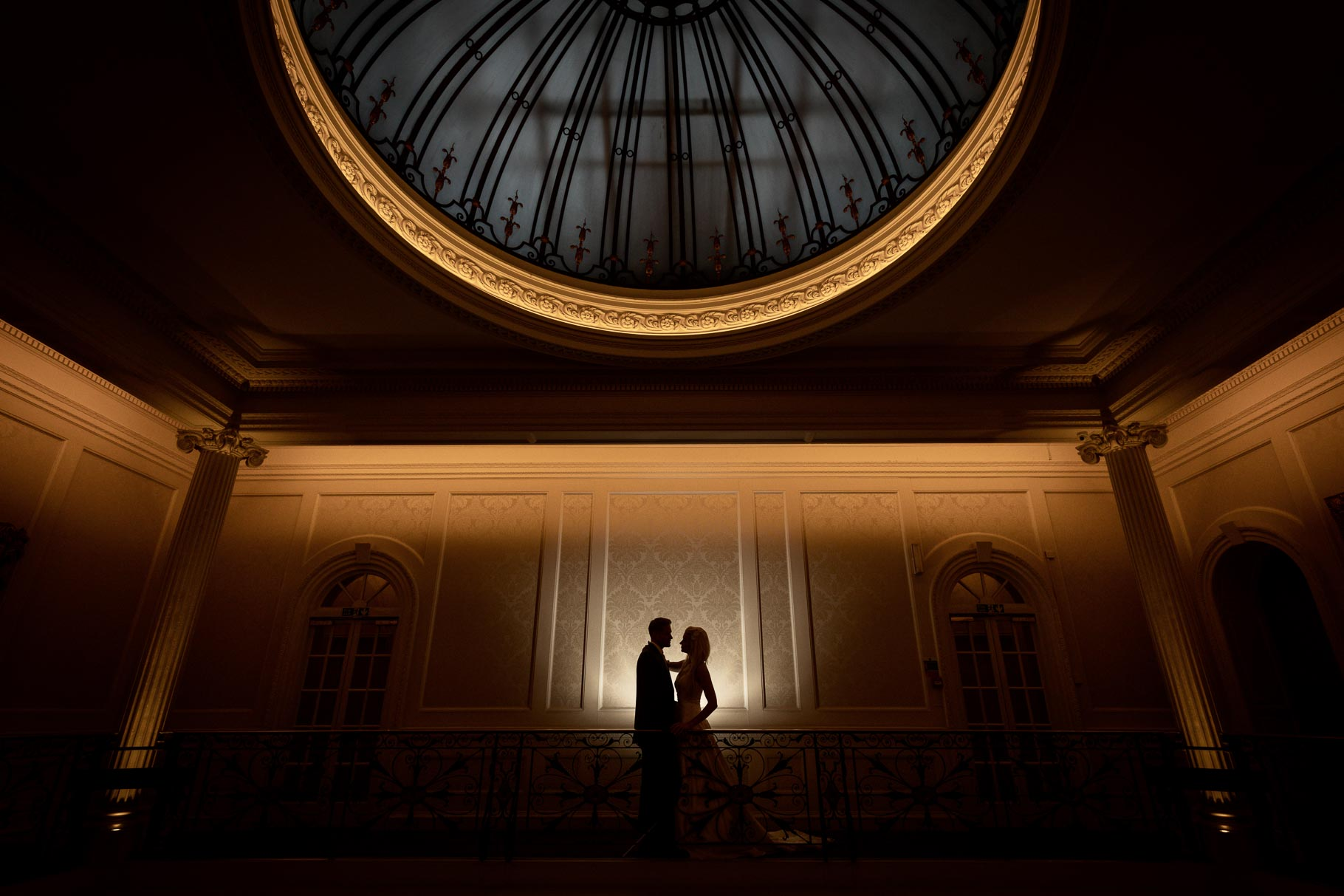 A silhouette portraits of a bride and groom